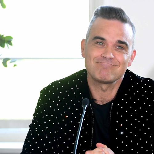 Robbie Williams Low-Key 'Tormented' Jimmy Page In Reno Feud