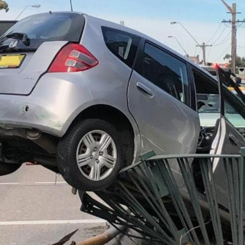 Car Ploughs Into Garbage Truck & Fence In Sydney