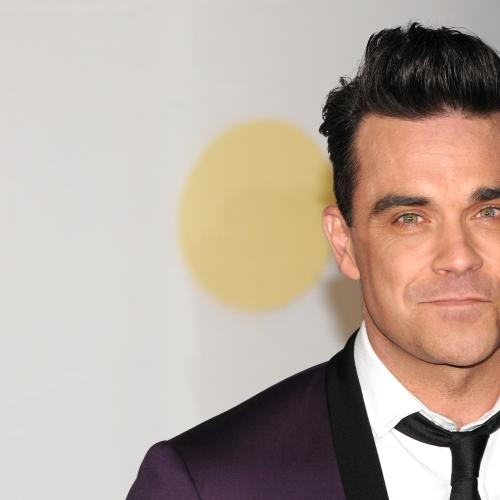 Robbie Williams Caught Disinfecting Hands After Touching Fan