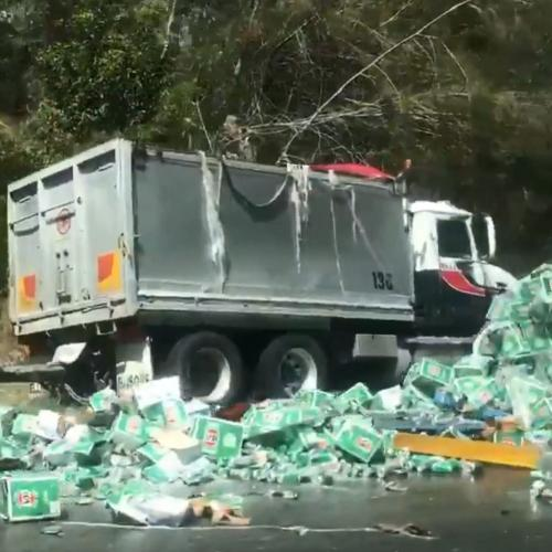 Heartbreaking Video Emerges Of Truck Full Of VB Crashing And Losing Its Load On NSW Highway