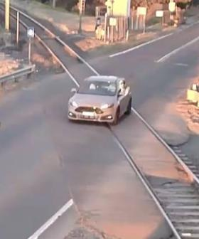 Driver's Terrifying Near Miss With Train At Level Crossing In Kembla Grange