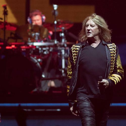 Why Def Leppard Didn't Let Go Of Drummer After His Arm Was Amputated