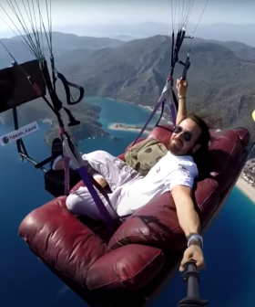 Man Flies His Entire Lounge Room Over The Ocean Because... Why Not?