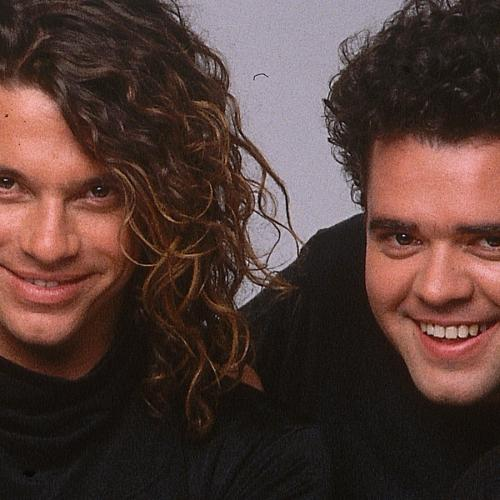 """""""We Were Really Fortunate"""": Andrew Farriss Reflects On Making Music With Michael Hutchence"""